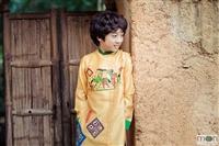 Áo dài cho bé trai thay đổi phong cách