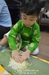 Áo dài gấm Thái Tuấn cho bé trai màu xanh lá AT65 họa tiết chữ Phúc Thọ